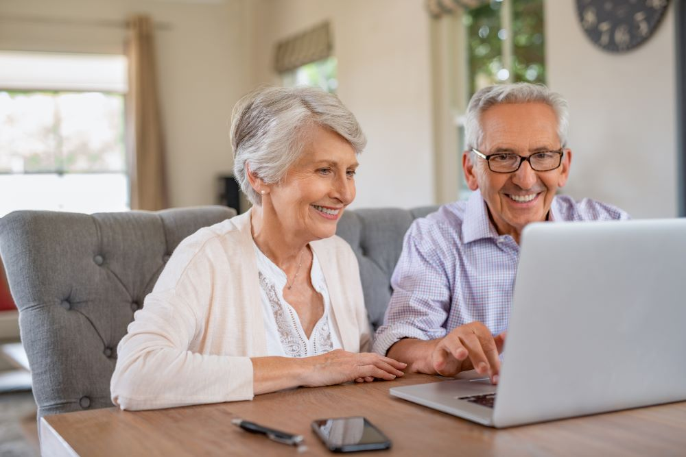 Autochair Virtual Assessment Elderly Couple Looking At A Laptop