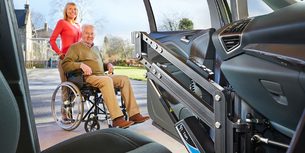 vehicle accessability transfer from wheelchair to vehicle with a person lift. Black Bedroom Furniture Sets. Home Design Ideas